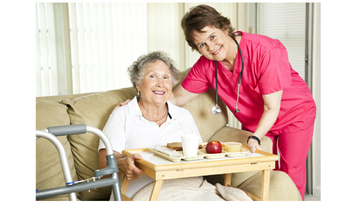 friendly-nurse-brings-a-mean-to-an-elderly-shut-in-could-also-be-lunch-time-at-the-nursing-home-shutterstock-image-id-69502159-copyright-lisa-f-young