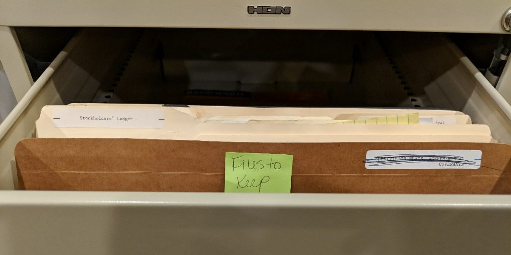 Personal business records organization example: file folder in a file cabinet marked Files to Keep, 2019 photo by Hawkins Law PC